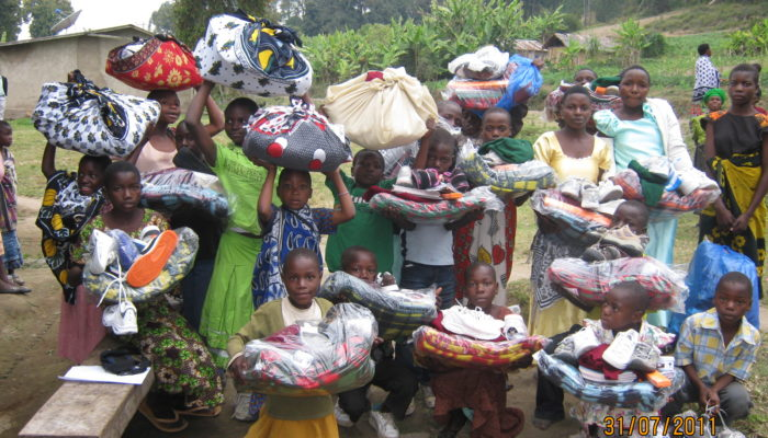 Isange students receiving items for school